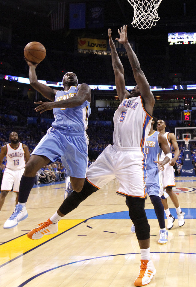 Photo - Oklahoma City's Kendrick Perkins (5) defends against Denver's Ty Lawson (3) during the first round NBA basketball playoff game between the Oklahoma City Thunder and the Denver Nuggets on Wednesday, April 20, 2011, at the Oklahoma City Arena. Photo by Sarah Phipps, The Oklahoman