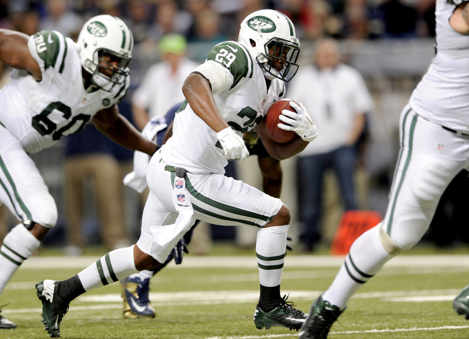 Photo -   New York Jets running back Bilal Powell heads for the end zone on a 5-yard touchdown run during the fourth quarter of an NFL football game against the St. Louis Rams, Sunday, Nov. 18, 2012, in St. Louis. (AP Photo/L.G. Patterson)