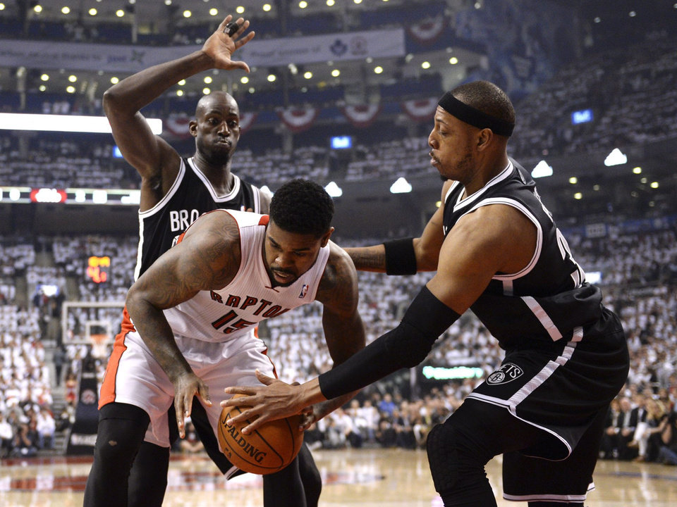 Photo - Toronto Raptors forward Amir Johnson, front left, battles with Brooklyn Nets' Paul Pierce, right, as Kevin Garnett, rear, defends during the first half of Game 2 in an NBA basketball first-round playoff series, Tuesday, April 22, 2014, in Toronto. (AP Photo/The Canadian Press, Frank Gunn)