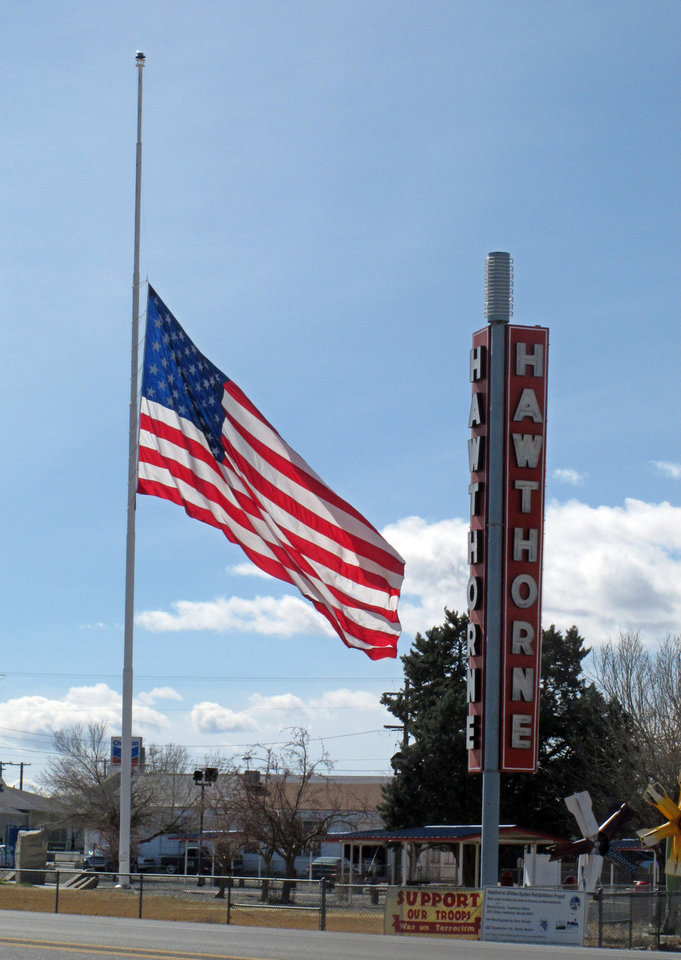 An American flag waves at half staff in the town of Hawthorne near the Hawthorne Army Depot on Tuesday, March 19, 2013, where seven Marines were killed and several others seriously injured in a training accident Monday night, about 150 miles southeast of Reno in Nevada\'s high desert. (AP Photo/Scott Sonner)
