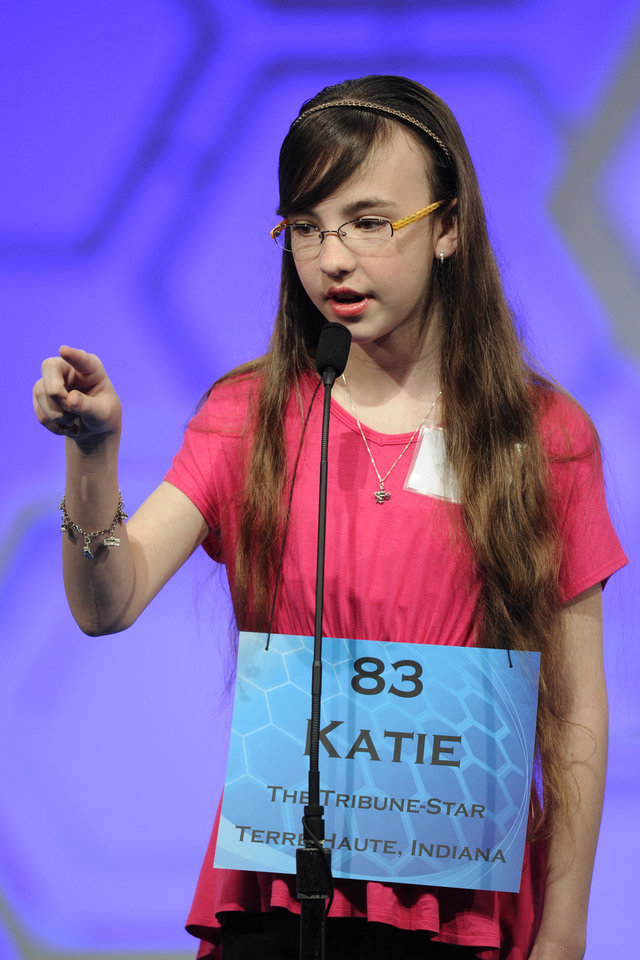 Photo - Katie Collins, 12, of Terre Haute, Ind,  spells the word during the 2015 Scripps National Spelling Bee in Oxon Hill, Md., Wednesday, May 27, 2015. (AP Photo/Cliff Owen)