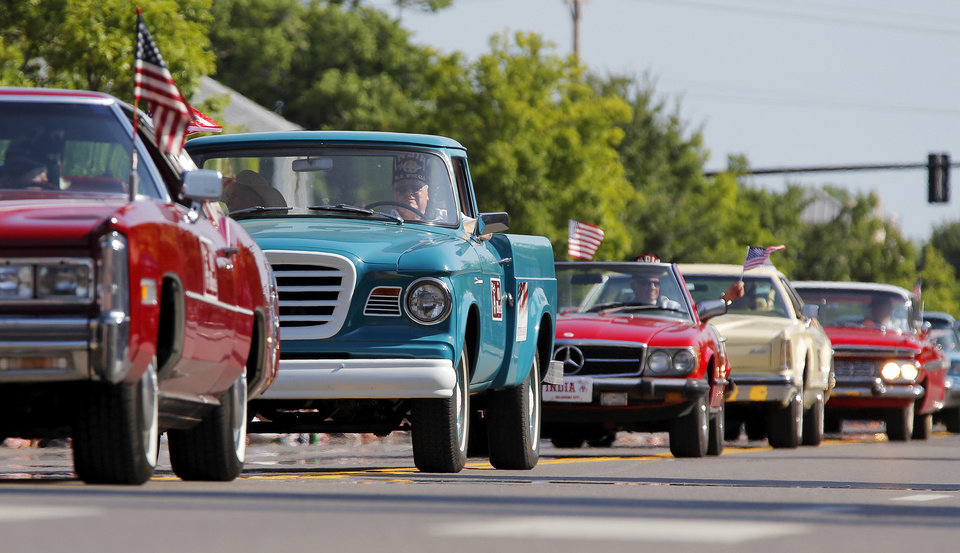 Photo - Members of the Old Wheels from the India Shriners drive their cars during the Edmond LibertyFest Parade in downtown Edmond, Okla., on Independence Day, Friday, July 4, 2014. Photo by Nate Billings, The Oklahoman