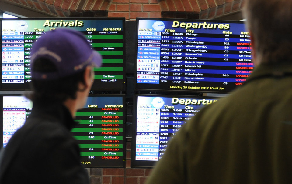 Photo -   Canceled tags litter the flight board at Albany International Airport, in Albany, N.Y., Monday morning, Oct. 29, 2012. Many flights in the northeast were canceled because of Hurricane Sandy. (AP Photo/Times Union, Will Waldron)