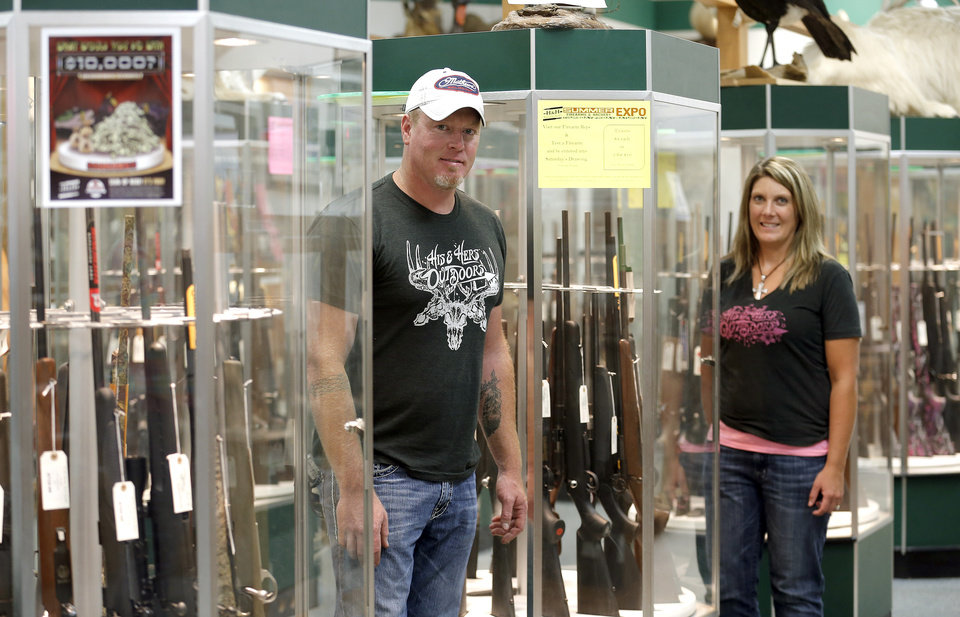Photo - Stacey Sissney and Jon Sissney pose for a photo at  H&H Shooting Sports, Friday July 19,  2013, in Oklahoma City. Photo by Sarah Phipps, The Oklahoman