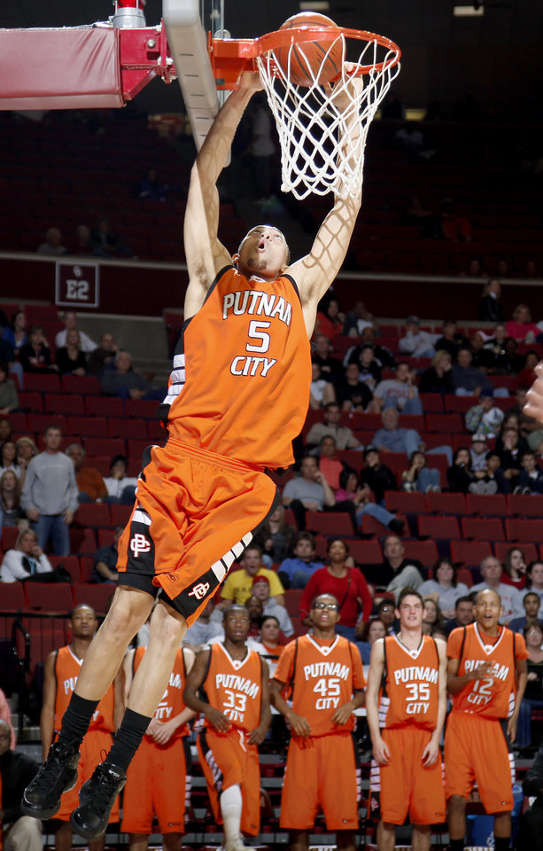 Putnam City's Kyle Hardrick dunks the ball during the Class 6A boys championship game between Putnam City and Jenks in the Oklahoma High School Basketball Championships at Lloyd Noble Arena in Norman, Okla., Saturday, March 14, 2009. PHOTO BY BRYAN TERRY, THE OKLAHOMAN