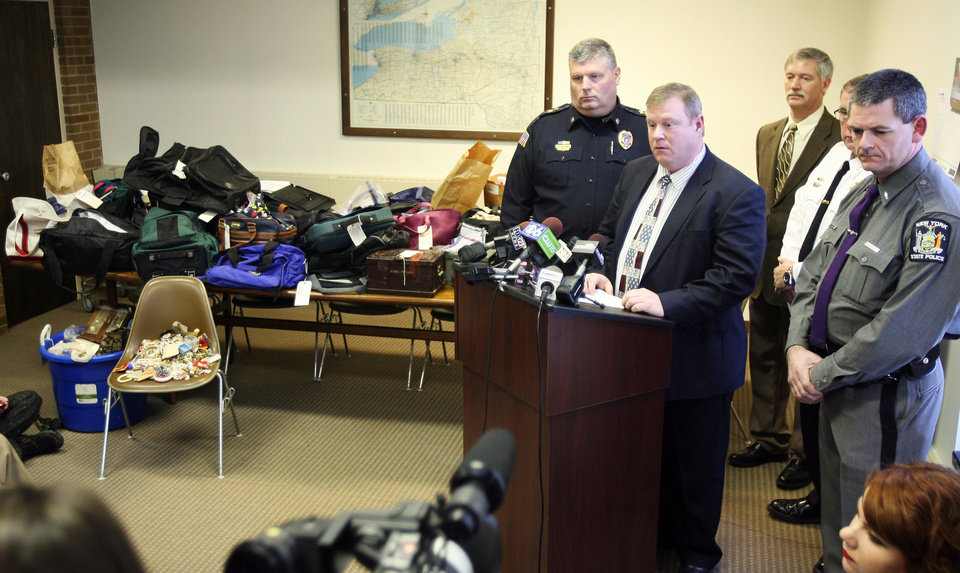 In this Jan. 2, 2013 photo, Hudson Falls Police Detective Scott Gillis talks to the media about evidence seized from a years-long burglary spree during a news conference at Hudson Falls Village Court in Hudson Falls, N.U. Few clues exist pointing to the owners of the roughly 30,000 items discovered after 39-year-old burglary suspect John Suddard�s recent arrest. So police are taking the novel step of displaying the items at the local high school Wednesday night, Jan. 9, 2013. (AP Photo/The Post-Star, Derek Pruitt)
