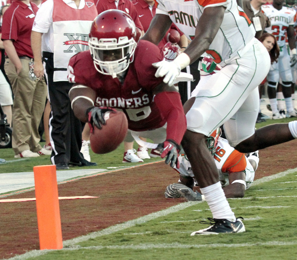 Damien Williams (26) leaps to the end zone for a touchdown in the first half during the college football game between the University of Oklahoma Sooners (OU) and Florida A&M Rattlers at Gaylord Family—Oklahoma Memorial Stadium in Norman, Okla., Saturday, Sept. 8, 2012. Photo by Steve Sisney, The Oklahoman