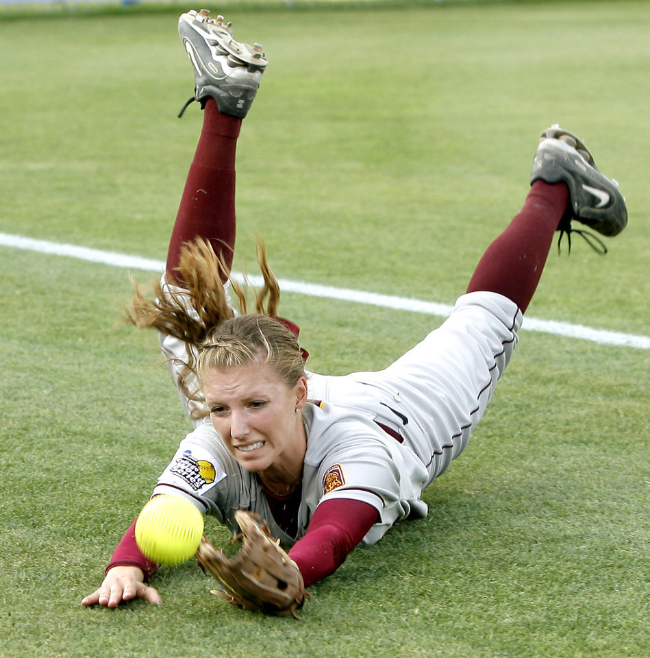 Photo - COLLEGE SOFTBALL: Arizona State's Lesley Rogers misses a foul ball in the second inning of the second championship game of the Women's College World Series between Texas A&M University and Arizona State University at ASA Hall of Fame Stadium in Oklahoma City, Tuesday, June 3, 2008. BY BRYAN TERRY, THE OKLAHOMAN ORG XMIT: KOD ORG XMIT: OKC0806032006109714 ORG XMIT: 0806032202409955
