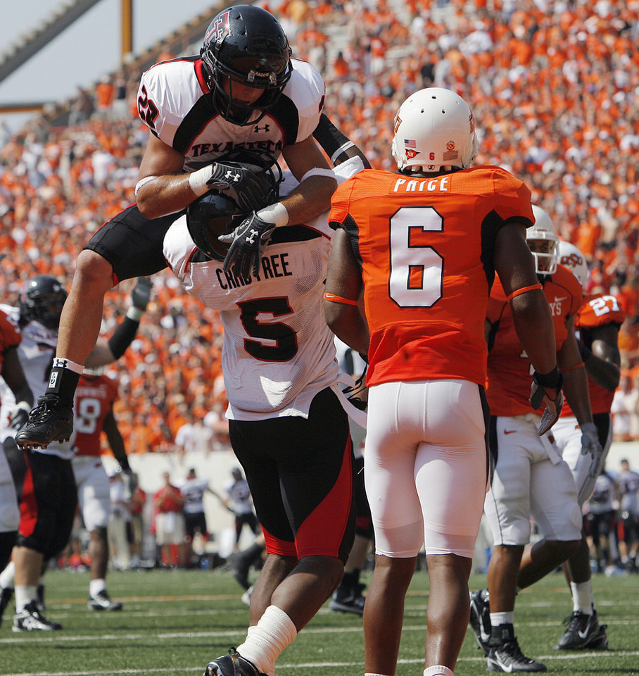 Oklahoma State\'s Ricky Price (6) watches as Texas Tech\'s Danny Amendola (20) and Michael Crabtree (5) celebrate after Crabtree\'s touchdown during the first half of the college football game between the Oklahoma State University Cowboys (OSU) and the Texas Tech University Red Raiders (TTU) at Boone Pickens Stadium in Stilllwater, Okla., on Saturday, Sept. 22, 2007. By NATE BILLINGS, The Oklahoman