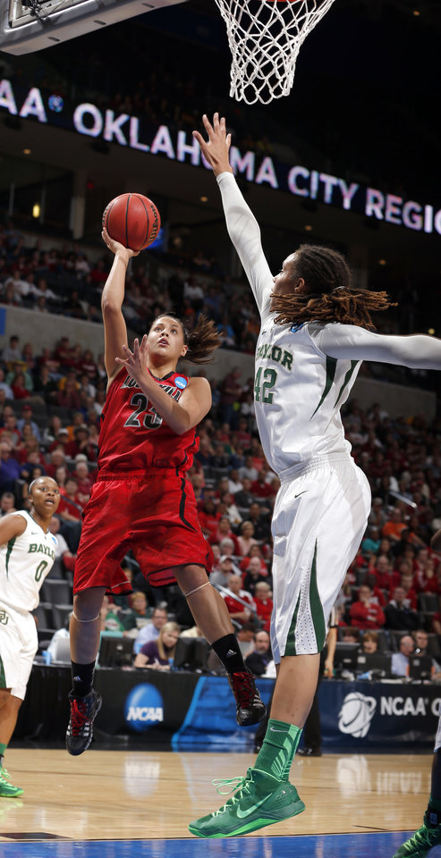 Louisville's Shoni Schimmel (23) shoots as Baylor's Brittney Griner (42) during college basketball game between Baylor University and the Louisville at the Oklahoma City Regional for the NCAA women's college basketball tournament at Chesapeake Energy Arena in Oklahoma City, Sunday, March 31, 2013. Photo by Sarah Phipps, The Oklahoman