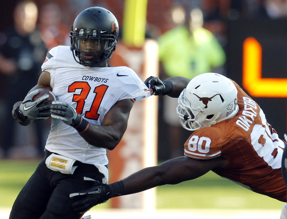 Photo - Oklahoma State's Jeremy Smith (31)tries to get by Texas' Alex Okafor (80) during second half of a college football game between the Oklahoma State University Cowboys (OSU) and the University of Texas Longhorns (UT) at Darrell K Royal-Texas Memorial Stadium in Austin, Texas, Saturday, Oct. 15, 2011. Photo by Sarah Phipps, The Oklahoman