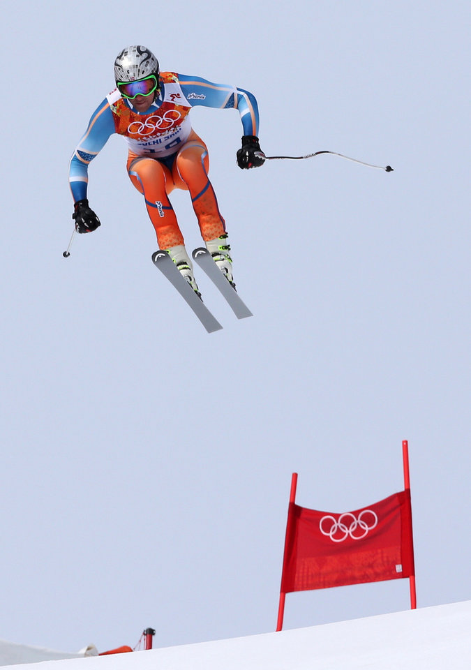 Photo - Norway's Aksel Lund Svindal jumps during the men's downhill at the Sochi 2014 Winter Olympics, Sunday, Feb. 9, 2014, in Krasnaya Polyana, Russia.(AP Photo/Luca Bruno)