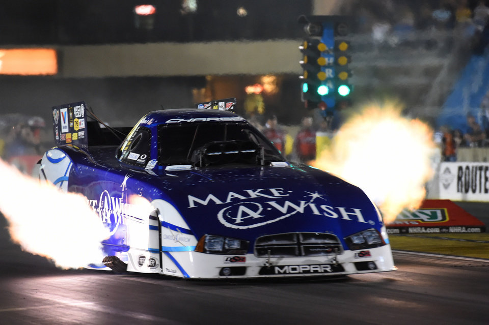 Photo - In the photo provided by the National Hod Rod Association, Tommy Johnson Jr. races to the number one qualifying position for the O'Reilly Auto Parts Route 66 NHRA Nationals drag races with a run of 3.999 seconds at 317.19 mph in Joliet, Ill. on Saturday, June 28, 2014. (AP Photo/NHRA, Teresa Long)