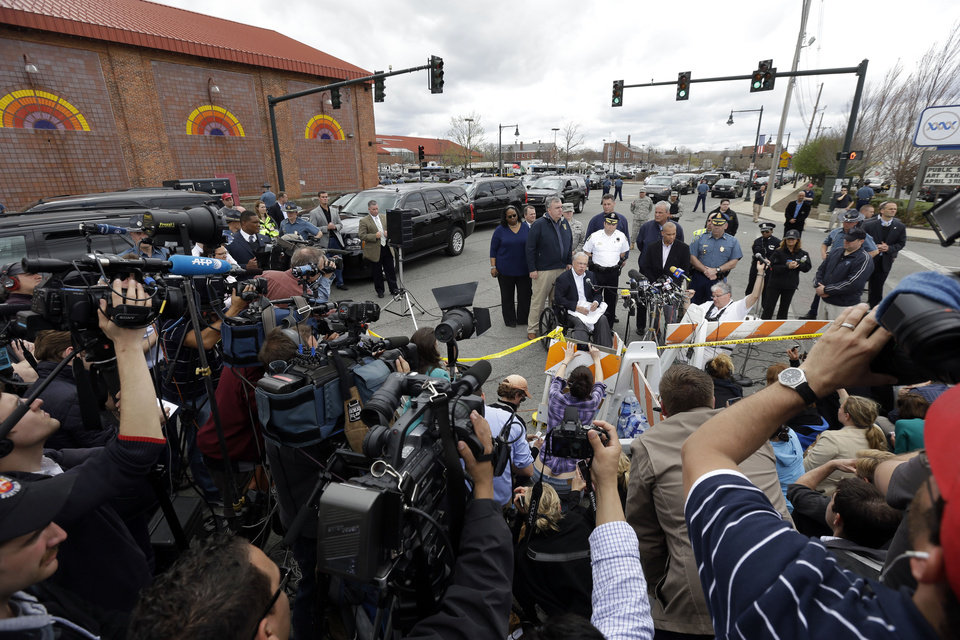 Massachusetts Gov. Deval Patrick, address members of the media near a the search area for a suspect in the Boston Marathon bombings, Friday, April 19, 2013, in Watertown, Mass.  The two suspects in the Boston Marathon bombing killed an MIT police officer and hurled explosives at police in a car chase and gun battle overnight that left one of them dead and his brother on the loose, authorities said Friday.  (AP Photo/Matt Rourke) ORG XMIT: MAMR138