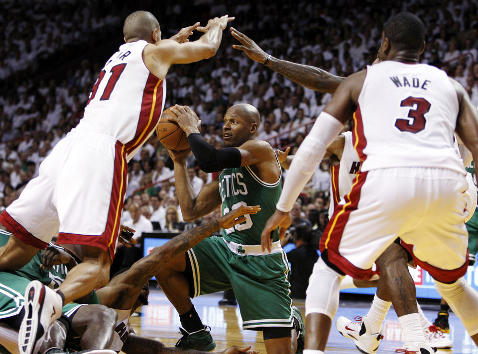 Photo -   File - In this June 5, 2012, file photo, Boston Celtics' Ray Allen (20) looks to pass the ball as Miami Heat's Shane Battier (31) and Dwyane Wade (3) defend during the second half of Game 5 in their NBA basketball Eastern Conference Finals playoff series in Miami. Allen told the Heat on Friday night, July 6, 2012, that he has decided to leave the Celtics and join up with the reigning NBA champions. (AP Photo/Lynne Sladky, File)