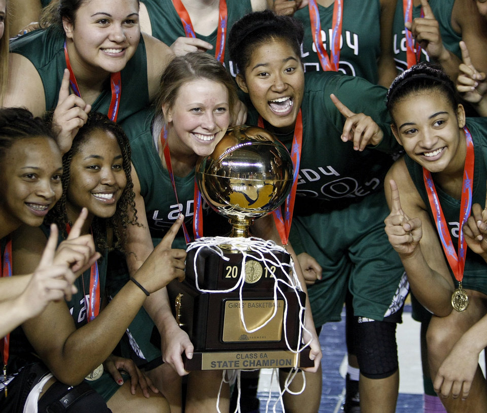 The Edmond Santa Fe Lady Wolves pose for a photo with the gold ball championship trophy after the Class 6A girls high school basketball state tournament championship game between Edmond Santa Fe and Edmond Memorial at the Mabee Center in Tulsa, Okla., Saturday, March 10, 2012. Santa Fe won, 44-41. Photo by Nate Billings, The Oklahoman
