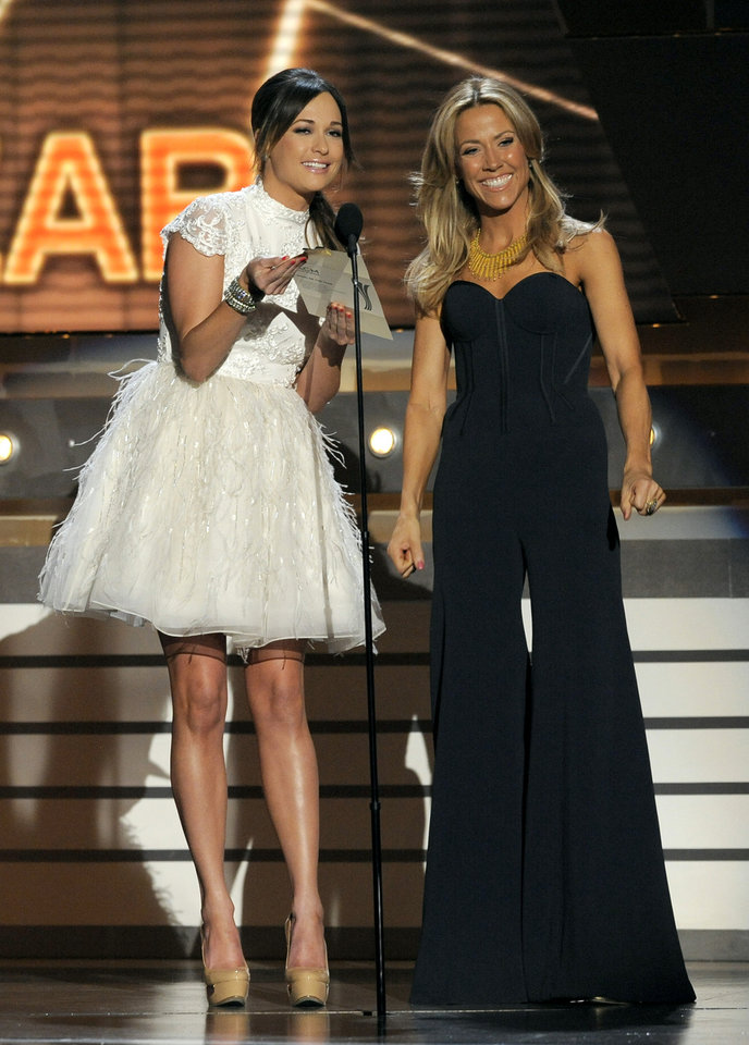 Singers Kacey Musgraves, left, and Sheryl Crow speak on stage at the 48th Annual Academy of Country Music Awards at the MGM Grand Garden Arena in Las Vegas on Sunday, April 7, 2013. (Photo by Chris Pizzello/Invision/AP) ORG XMIT: NVPM276
