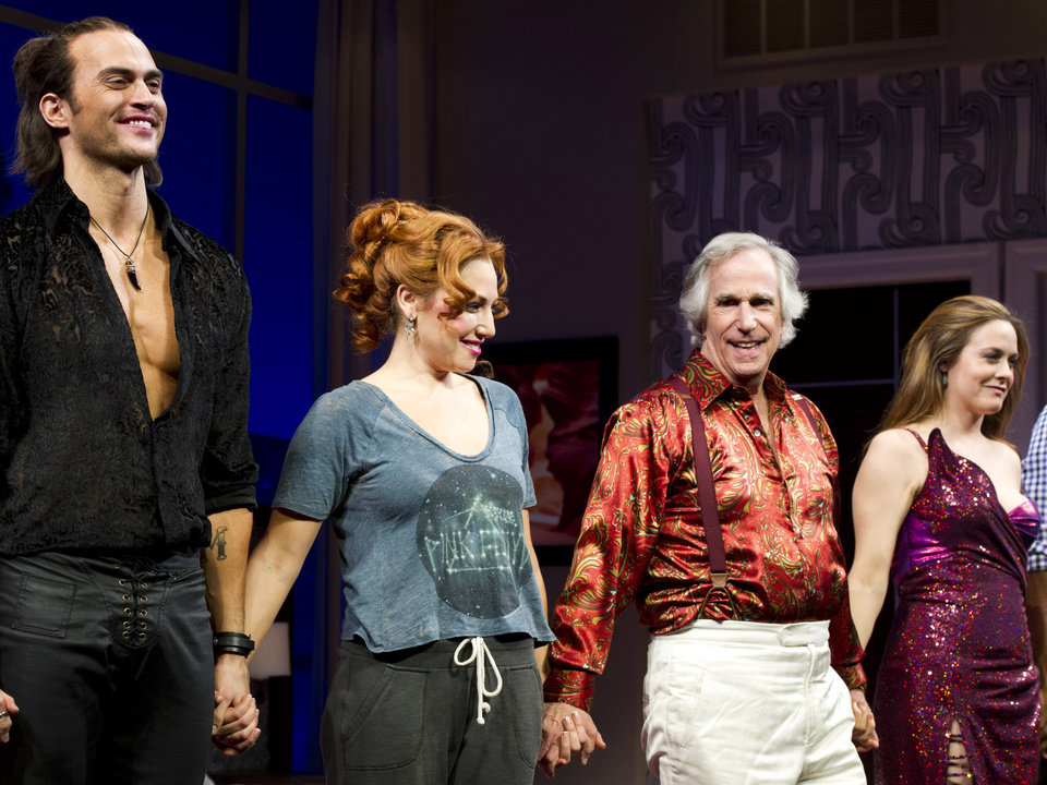 "From left, Cheyenne Jackson, Ari Graynor, Henry Winkler and Alicia Silverstone on stage at the curtain call for the opening night performance of the Broadway play, ""The Performers,"" on Wednesday, Nov. 14, 2012, in New York. (Photo by Charles Sykes/Invision/AP)"