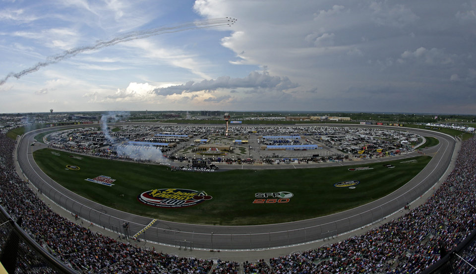 Photo - Planes fly over before a NASCAR Sprint Cup Series auto race at Kansas Speedway in Kansas City, Kan., Saturday, May 10, 2014. (AP Photo/Charlie Riedel)