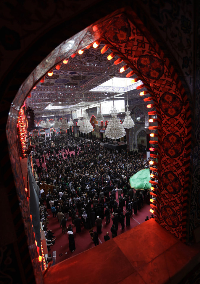 Shiite Muslim worshippers gather inside the holy shrine of Imam Hussein to mark the Muslim festival of Ashoura, an important period of mourning for Shiites in Karbala, 50 miles (80 kilometers) south of Baghdad, Iraq, Saturday Nov. 24, 2012. The festival of Ashoura commemorates the martyrdom of Imam Hussein, the grandson of Prophet Muhammad at the Battle of Karbala, Iraq, in the year A.D. 680. (AP Photo/Khalid Mohammed)
