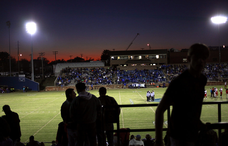 JELSMA STADIUM / THE ROCK / STADIUM / HIGH SCHOOL FOOTBALL: Fans make their way to their seats before Guthrie's game against Western Heights in Guthrie on Friday, Oct. 28, 2011. Photo by John Clanton, The Oklahoman ORG XMIT: KOD