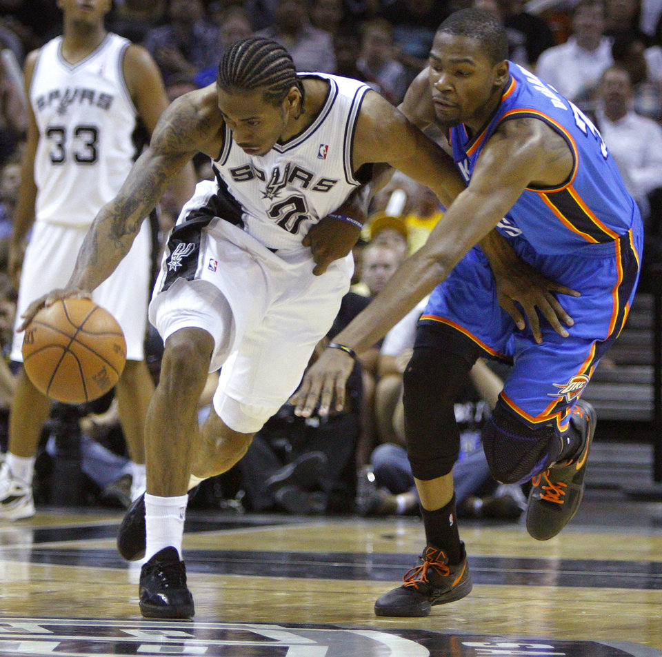 Photo - San Antonio's Kawhi Leonard (2) steals the ball from Oklahoma City's Kevin Durant (35) during Game 1 of the Western Conference Finals between the Oklahoma City Thunder and the San Antonio Spurs in the NBA playoffs at the AT&T Center in San Antonio, Texas, Sunday, May 27, 2012. Photo by Bryan Terry, The Oklahoman