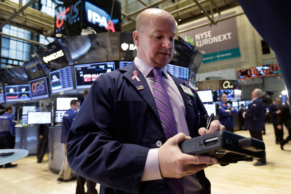Photo - Trader Patrick Casey works on the floor of the New York Stock Exchange, Monday, April 7, 2014.  Stocks are starting out the week the same way they ended the last one — down. (AP Photo/Richard Drew)
