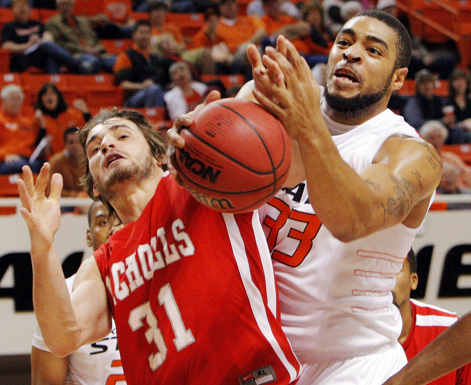Photo - OSU's Marshall Moses (33), right, and Anatoly Bose (31) of Nicholls State chase a loose ball in the first half during the men's college basketball game between Nicholls State University and Oklahoma State University at Gallagher-Iba Arena in Stillwater, Okla., Saturday, Nov. 21, 2010. Photo by Nate Billings, The Oklahoman