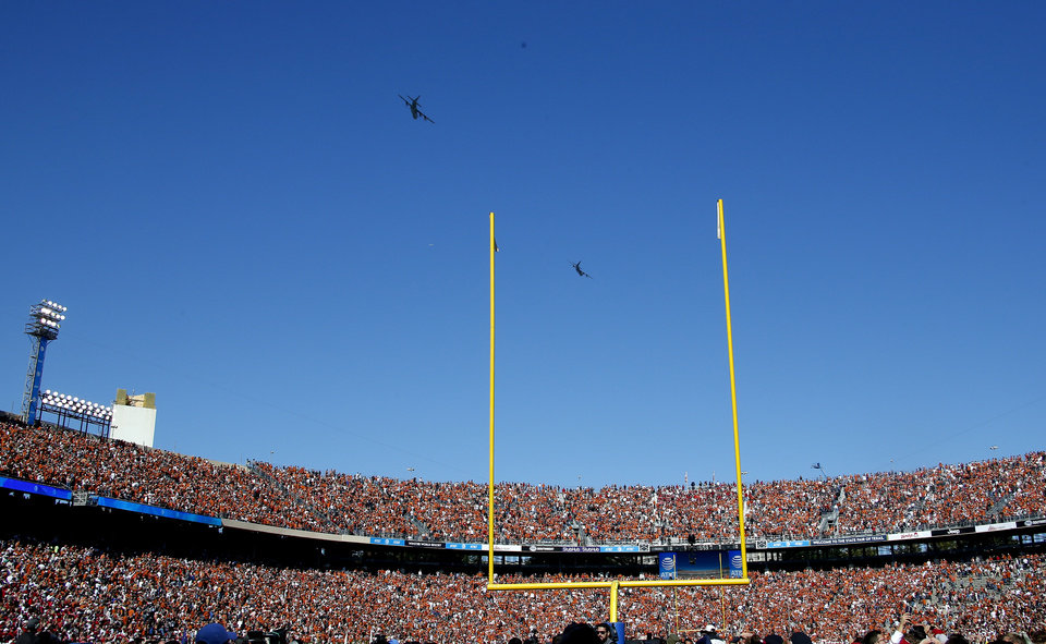 Photo - Planes fly over the Cotton Bowl before the Red River Showdown college football game between the University of Oklahoma Sooners (OU) and the Texas Longhorns (UT) at Cotton Bowl Stadium in Dallas, Saturday, Oct. 12, 2019. OU won 34-27. [Sarah Phipps/The Oklahoman]