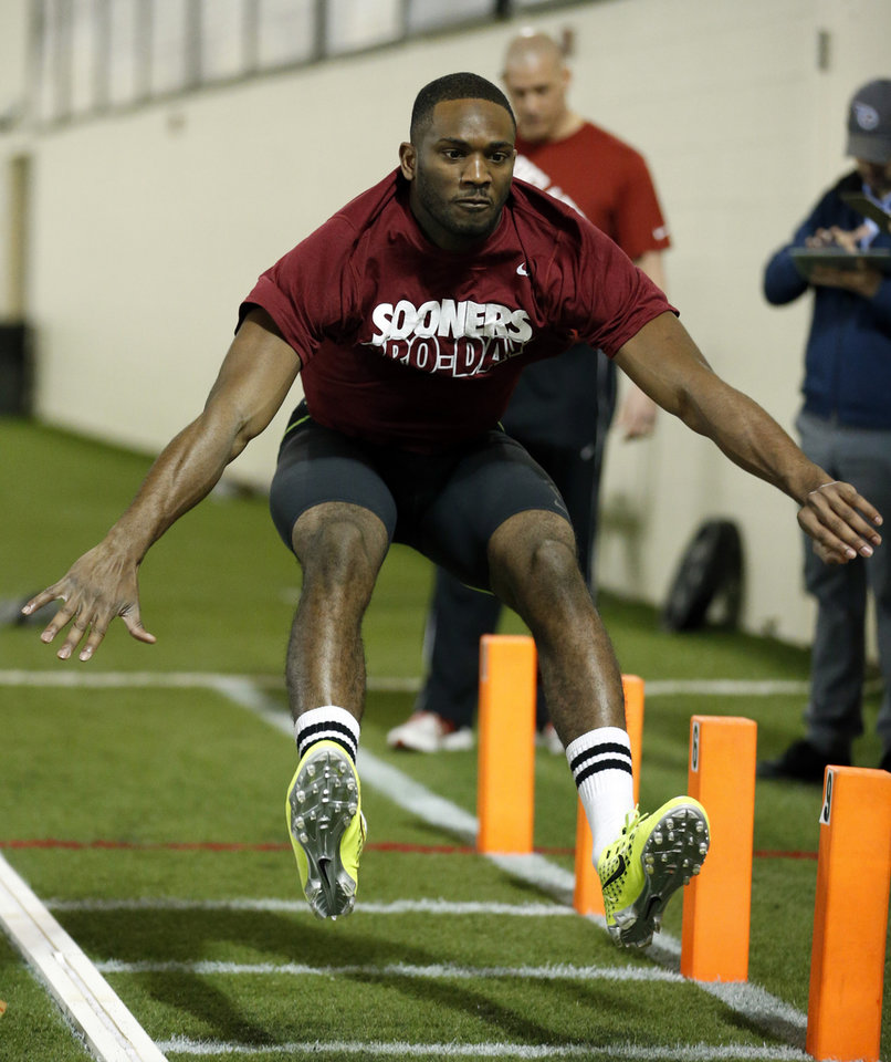Photo - Jaz Reynolds shows his broad jump skills as the University of Oklahoma holds Pro Day at the Everest Training Center in Norman, Okla., on Wednesday, March 12, 2014. Photo by Steve Sisney, The Oklahoman