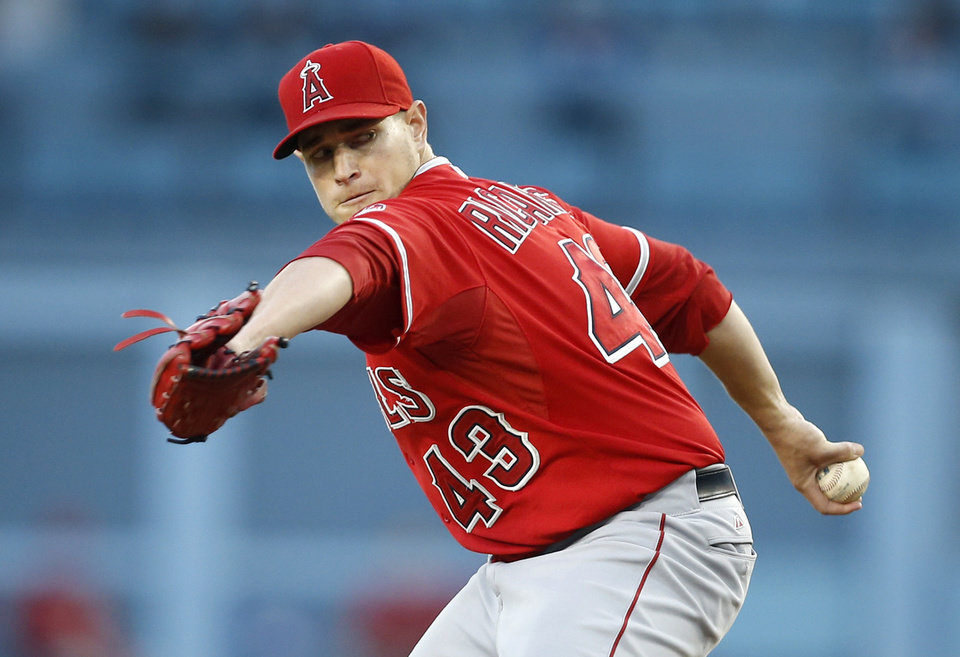 Photo - Los Angeles Angels starting pitcher Garrett Richards delivers against the Los Angeles Dodgers during the first inning of a baseball game, Monday, August 4, 2014, in Los Angeles. (AP Photo/Danny Moloshok)
