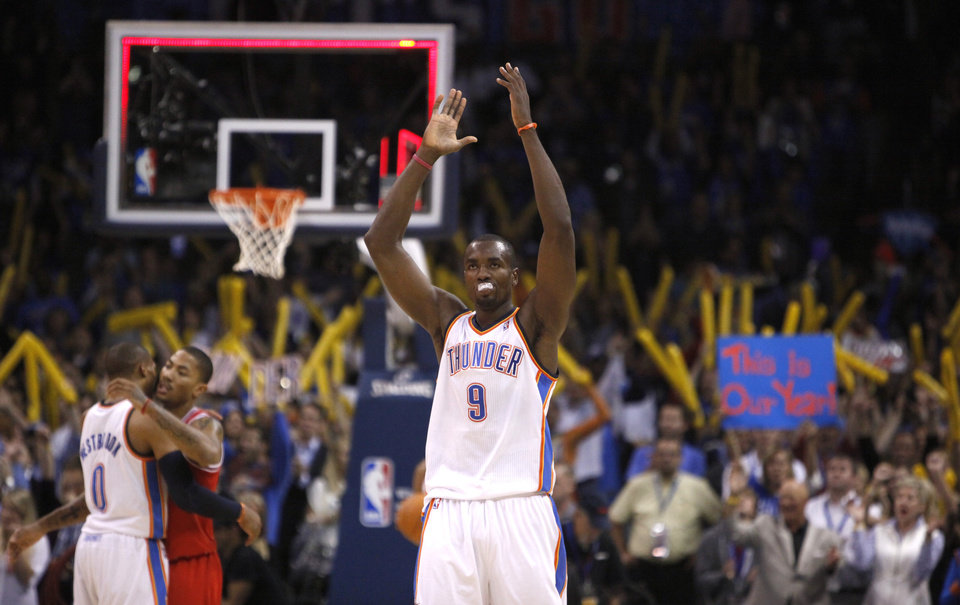 Photo - Oklahoma City's Serge Ibaka celebrates the Thunder's win over Chicago during the NBA season opener basketball game in the Oklahoma City Arena on Wednesday, Oct. 27, 2010. Photo by Sarah Phipps, The Oklahoman