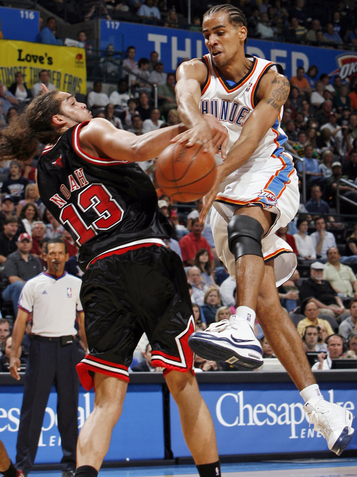 Oklahoma City's Thabo Sefolosha (2) passes the ball around Joakim Noah (13) of Chicago in the second half of the NBA basketball game between the Chicago Bulls and the Oklahoma City Thunder at the Ford Center in Oklahoma City, Wednesday, March 18, 2009. Chicago won, 103-96. PHOTO BY NATE BILLINGS, THE OKLAHOMAN