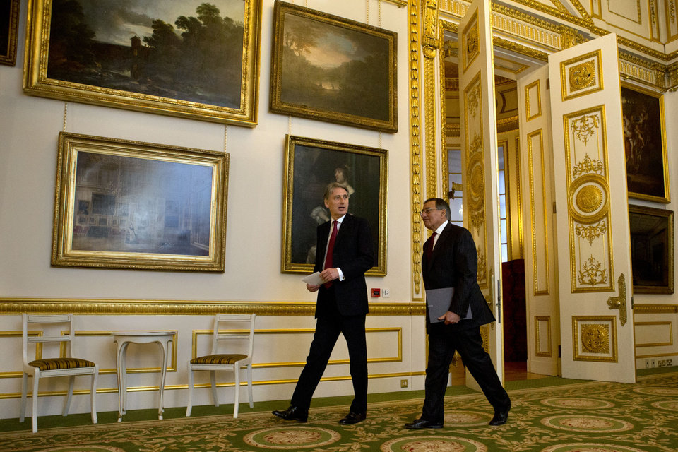 U.S. Defense Secretary Leon Panetta and Britain's Secretary of State for Defense Philip Hammond arrive for a news conference at Lancaster House in London on Saturday, Jan. 19, 2013. (AP Photo/Jacquelyn Martin)