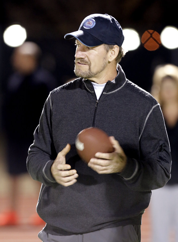 Photo - Bill Cowher watches the players at a clinic at Southmoore High school for two teams from the Oklahoma Elite Football League Wednesday, November 20, 2013. Photo by Doug Hoke, The Oklahoman