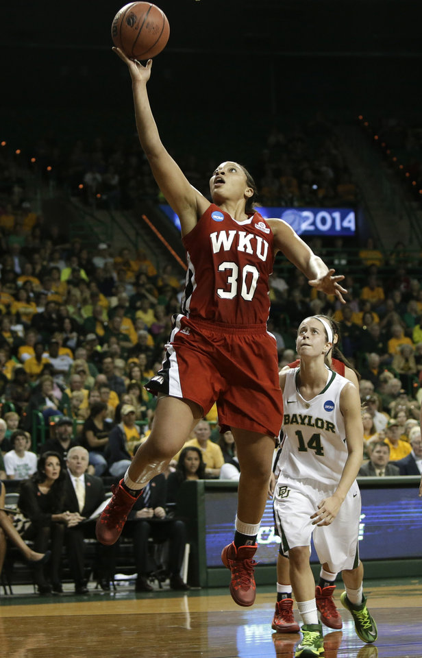 Photo - Western Kentucky's Chastity Gooch (30) gets by Baylor's Makenzie Robertson (14) for a shot during the first half of a first-round game in the NCAA women's college basketball tournament, Saturday, March 22, 2014, in Waco, Texas. (AP Photo/Tony Gutierrez)