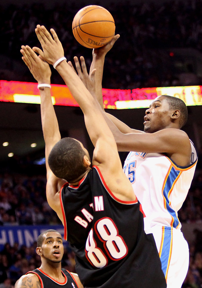 Oklahoma City's Kevin Durant puts up a shot over Portland's Nicolas Batum during their NBA basketball game at the Ford Center in Oklahoma City, Okla., on Sunday, March 28, 2010. Photo by John Clanton, The Oklahoman