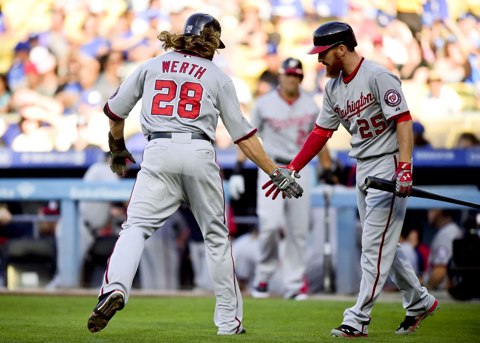 Photo - Washington Nationals right fielder Jayson Werth (28) celebrates a solo homerun with teammate Adam LaRoche (25) in the first inning of a baseball game against the Los Angeles Dodgers, Monday, Sept. 1, 2014, in Los Angeles. (AP Photo/Gus Ruelas)