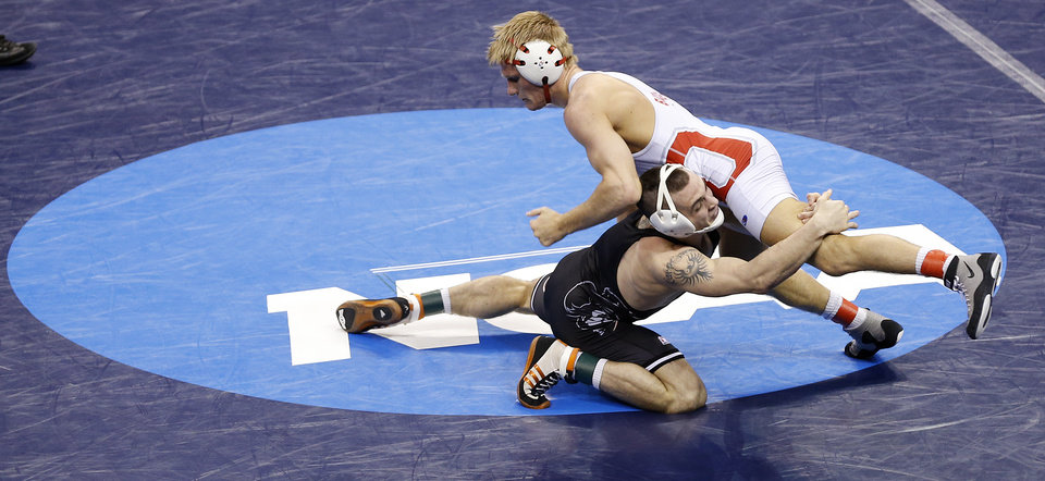 Photo - Oklahoma State's Joshua Kindig takes on Ohio State's Ian Paddock in the 149 pound match during the 2014 NCAA Div. 1 Wrestling Championships at Chesapeake Energy Arena in Oklahoma City, Okla. on Thursday, March 20, 2014. Photo by Chris Landsberger, The Oklahoman