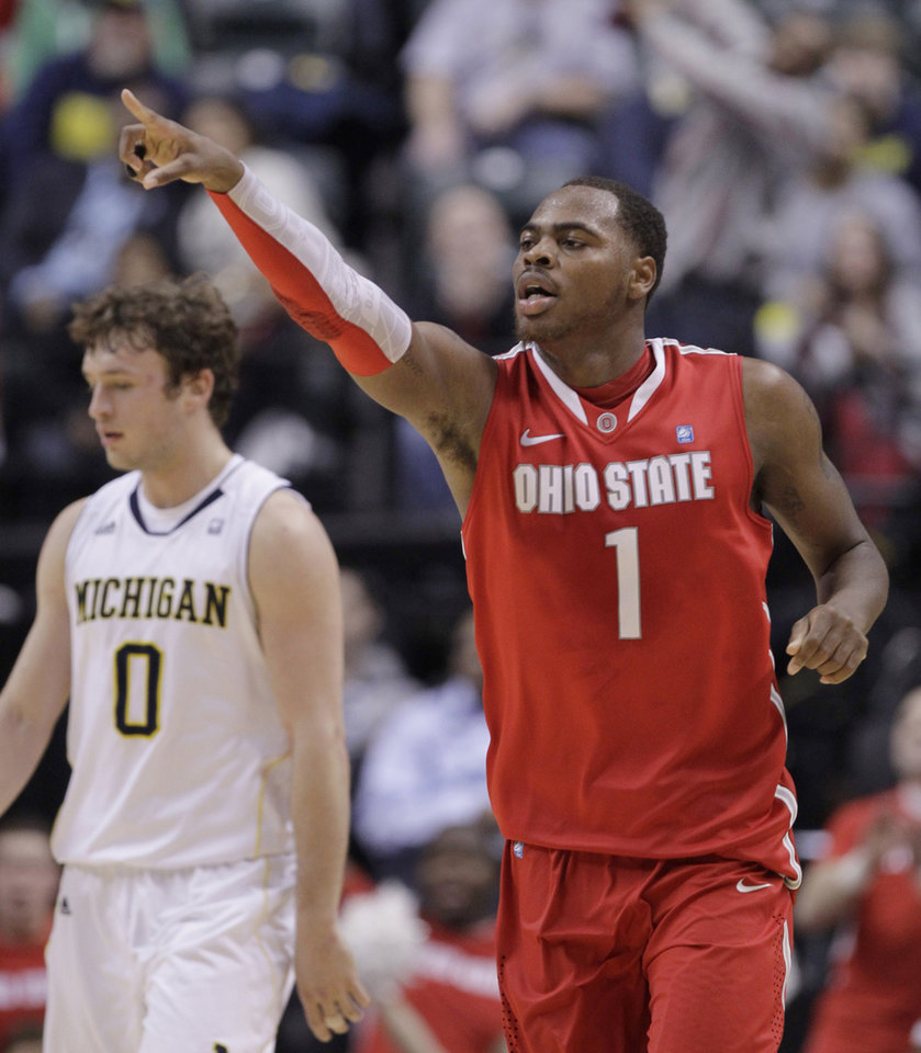 Photo -   Ohio State forward Deshaun Thomas (1) reacts in the second half of an NCAA college basketball game in the semifinals of the Big Ten Conference tournament in Indianapolis, Saturday, March 10, 2012. At left is Michigan forward Zack Novak (0). (AP Photo/Michael Conroy)