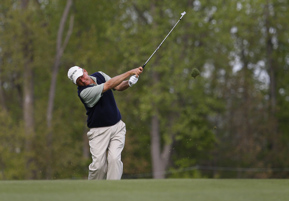 Photo - Mark Brooks hits a fairway shot on the 16th hole during the first round of the Senior PGA Championship golf tournament at Harbor Shores Golf Club in Benton Harbor, Mich., Thursday, May 22, 2014. (AP Photo/Paul Sancya)