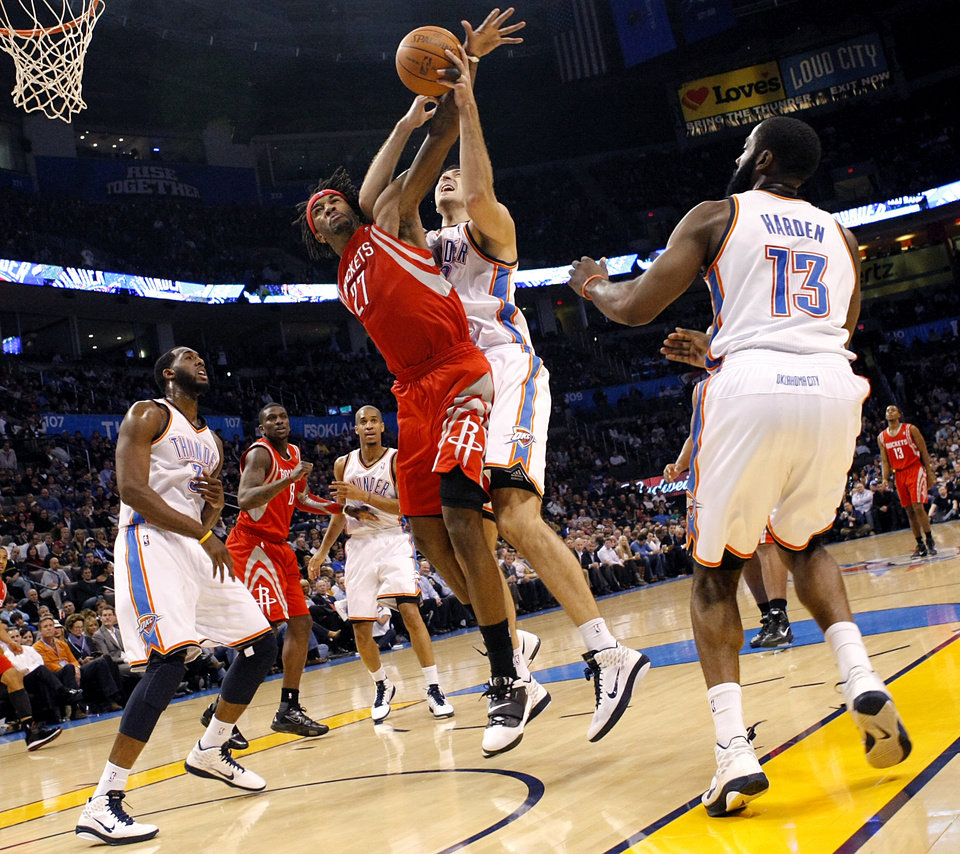 Photo - Oklahoma City's Nenad Krstic disrupts a shot by Houston's Jordan Hill  during their NBA basketball game at the OKC Arena in downtown Oklahoma City on Wednesday, Nov. 17, 2010. The Thunder beat the Rockets 116-99. Photo by John Clanton, The Oklahoman