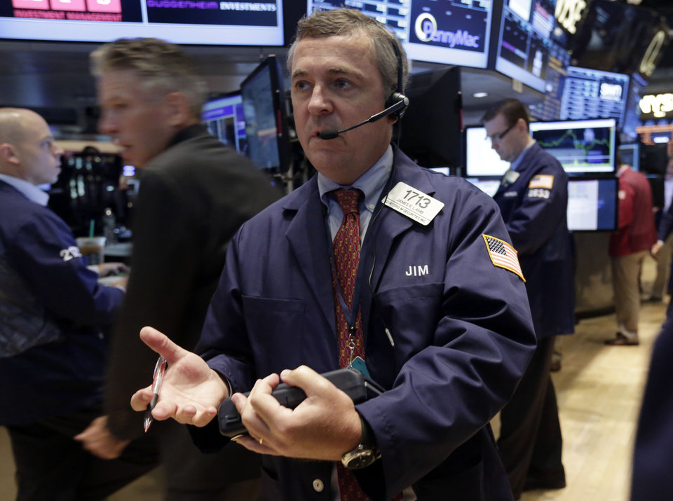 Photo - Trader James Lamb works on the floor of the New York Stock Exchange Friday, Aug. 16, 2013. Stocks bounced back Friday from consecutive days of significant declines, with more evidence of a rebounding U.S. housing market.(AP Photo/Richard Drew)