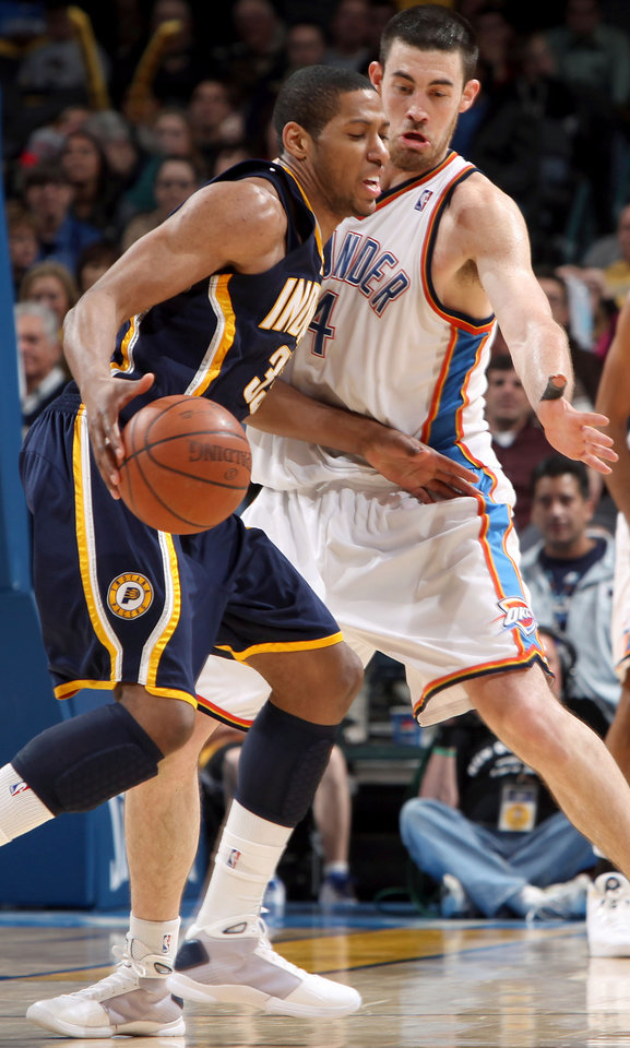 Photo - Oklahoma City's Nick Collison tries to slow down Indiana's Danny Granger during the NBA basketball game between the Indiana Pacers and the Oklahoma City Thunder at the Ford Center in Oklahoma City, Sunday, April 5, 2009. The Thunder lost 117 to 99. Photo by John Clanton, The Oklahoman