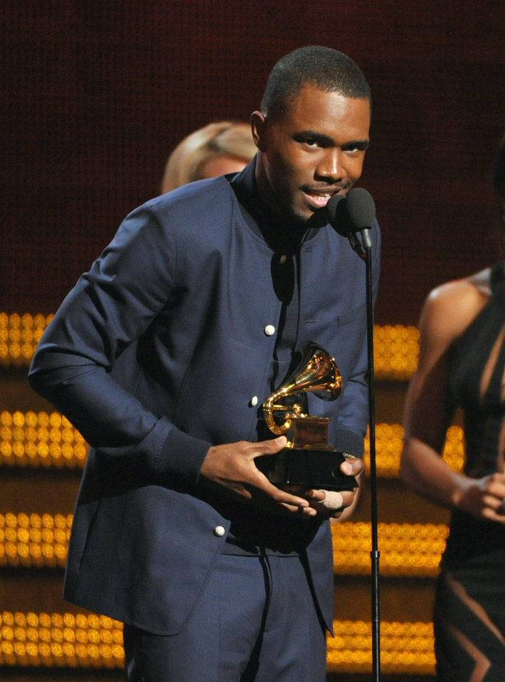 Photo - Frank Ocean accepts the award for best urban contemporary album at the 55th annual Grammy Awards on Sunday, Feb. 10, 2013, in Los Angeles. (Photo by John Shearer/Invision/AP)