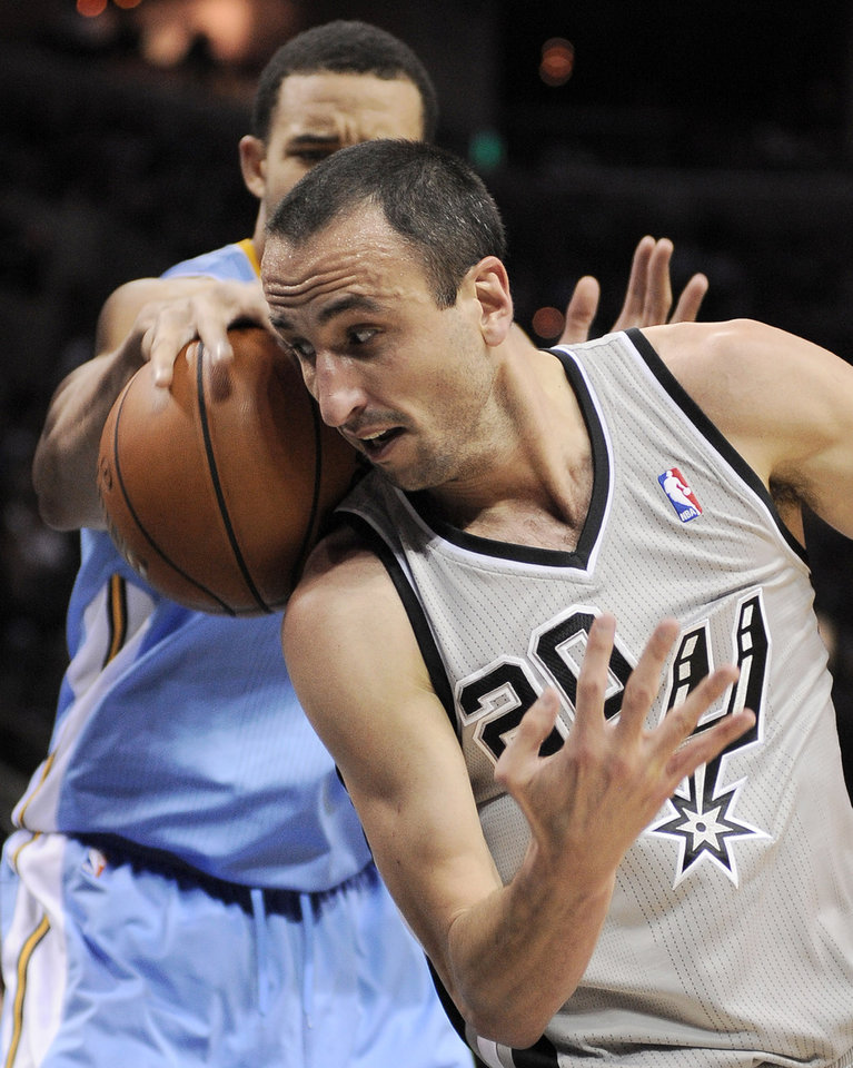 San Antonio Spurs\' Manu Ginobili, front, of Argentina, scrambles for a loose ball with Denver Nuggets\' JaVale McGee during the first half of an NBA basketball game, Saturday, Nov. 17, 2012, in San Antonio. (AP Photo/Darren Abate)