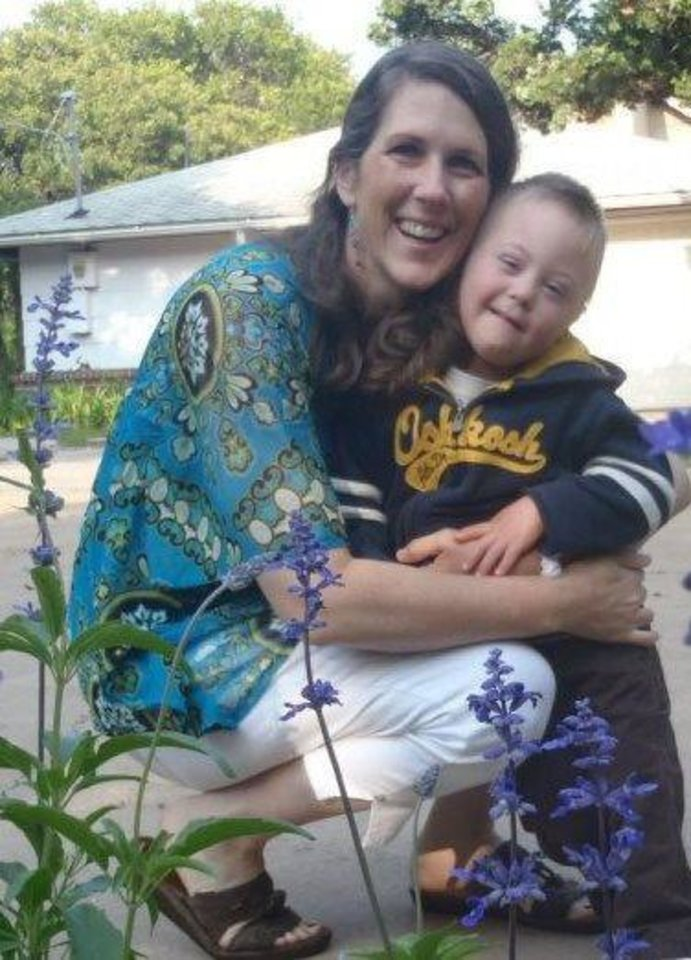 Photo - Dana Poulter, Edmond, hugs son Nathaniel, 5. Dana Poulter is president of the Down Syndrome Assocation of Central Oklahoma. PHOTO PROVIDED