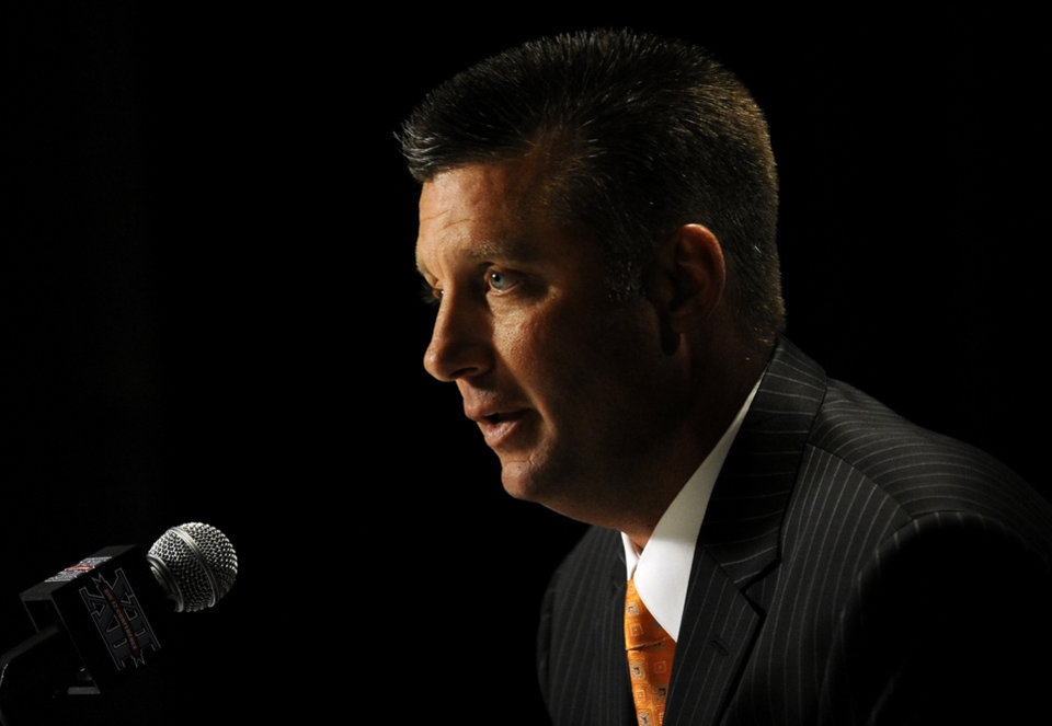 Photo - Oklahoma State head coach Mike Gundy answers questions during NCAA college football Big 12 Media Days, Monday, July 25, 2011, in Dallas. (AP Photo/Matt Strasen)