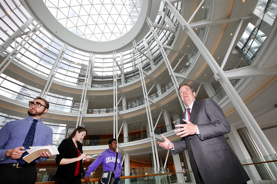 Photo - Devon Energy Corp. Executive Chairman Larry Nichols leads a tour of Devon Energy Center, which was recognized Monday for earning gold certification for Leadership in Energy and Engineering Design. Photo by David McDaniel, The Oklahoman