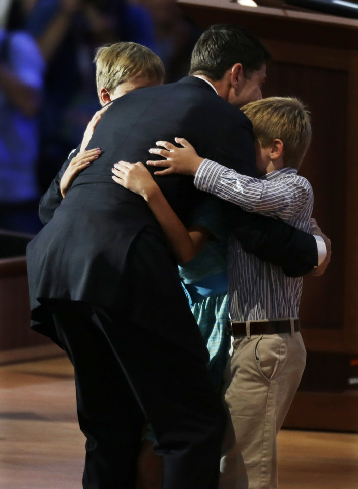 Photo -   Republican vice presidential nominee, Rep. Paul Ryan is hugged by his sons Charlie and Sam after his acceptance speech during the Republican National Convention in Tampa, Fla., on Wednesday, Aug. 29, 2012. . (AP Photo/Lynne Sladky)